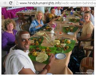 Hindu priest with foreign guests...Banana leaves used as plate in traditional way has multiple benefits.....Food tastes great on fresh banana leaves, leaves are eco-friendly, cows/pets can eat it after you finish so there is no wastage or garbage, most impotently you are forced to grow healthy banana trees for fruit / for dish / to purify air around your home....Thus, overall it has green sustainable effect!! ...This was a deep spiritual & scientific thinking by Hindu Scholars in ancient India for promoting this eating practice.