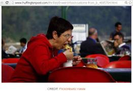 A lady eating food @ US...
