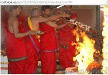 "Hindu Priests offering ""Samidha"" ( Herbs)in Yajna"