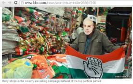 Election shop salesman weaing differnt party accessories!