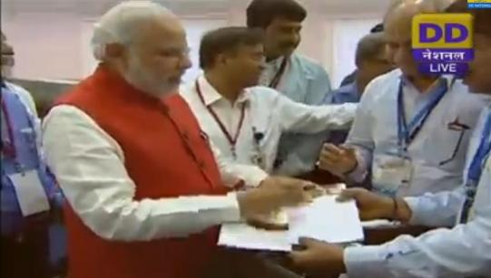 Scientists wants to capture the moment with PM's authograph!